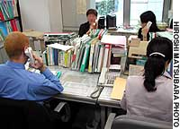 Counselors at AMDA International Medical Information Center's Tokyo office in Shinjuku refer foreigners to medical institutions that can accommodate them.