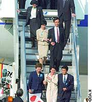 Kyoko Nakayama (front left), a special adviser at the Cabinet Secretariat, accompanies five abductees as they arrive at Tokyo's Haneda airport.