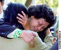 Abductee Hitomi Soga hugs a former classmate during a reunion in her hometown of Mano on Sado Island.