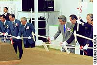 Prime Minister Junichiro Koizumi is among the dignitaries breaking ground at the Aichi Expo 2005 site, together with Shoichiro Toyoda (center), chairman of the expo organizing body.
