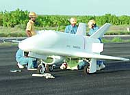 Engineers check  an unmanned test vehicle Friday on Christmas Island in the South Pacific after the it flew a planned route in autopilot mode. NATIONAL SPACE DEVELOPMENT AGENCY PHOTO