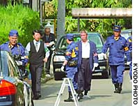 Police investigators search the area around the house of Lower House member Koki Ishii Friday morning.