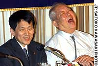 Nobel Laureates Koichi Tanaka (left) and Masatoshi Koshiba react during a joint appearance before the Foreign Correspondents' Club of Japan in Tokyo.