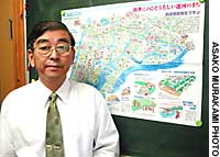 Yasakazu Asano, head of a citizens' group in Amagasaki, Hyogo Prefecture, displays a map drawn up by local residents depicting their plans for an area long plagued by air pollution.