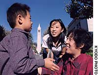 Chinese sociologist  Chen Lixing takes her son Yisi and daughter Yixing around the campus of the University of California, Berkeley.