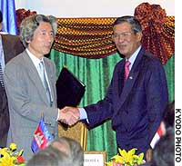 Prime Minister Junichiro Koizumi and Cambodian Prime Minister Hun Sen shake hands after signing  the agreement between the Association of Southeast Asian Nations and Japan in Phnom Penh.
