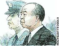 Lower House member Muneo Suzuki appears before the Tokyo District Court for the opening of his trial on bribery and other charges.