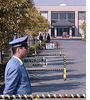 A guard mans the gate of Nagoya Prison, where inmates have allegedly been mistreated.