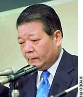 Former Tokushima Gov. Toshio Endo pauses during a news conference Friday at the Tokyo District Court after receiving a suspended prison term for bribery.