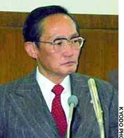 Okimi Mayor Hidekazu Tanimoto attends a town assembly session, during which he announced his resignation.