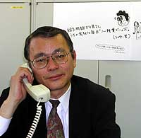 Tomoru Yamaguchi, a director at the Japanese Trade Union Confederation (Rengo), receives a call at his office in Tokyo's Chiyoda Ward. | YUMI WIJERS-HASEGAWA PHOTO