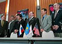 A group of astronauts, including Japan's Mamoru Mohri (second from right), and members of the Association of Space Explorers after a news conference in Tokyo.