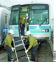 Workers inspect emergency equipment on subway cars at the Teito Rapid Transit Authority's maintenance facility in Koto Ward, Tokyo.