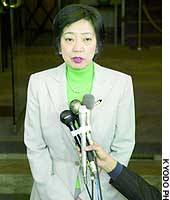 Osaka Gov. Fusae Ohta fields questions from reporters after the Japan Sumo Association rejected her latest request to be allowed to enter the sumo ring.
