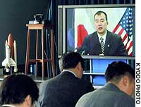 Astronaut Soichi Noguchi speaks from Houston to reporters at the head office of the National Space Development Agency of Japan.