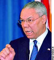 U.S. Secretary of State Colin Powell answers questions at the U.S. Embassy in Tokyo.