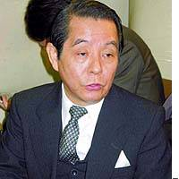 Former Labor Minister Toshio Yamaguchi fields questions after the Tokyo High Court rejected his appeal against a lower court conviction for fraud and embezzlement.