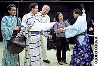 Gena Umali (second from right) directs University of the Philippines actors during a recent dress rehearsal of that nation's first kabuki performance.
