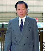 Former Recruit Co. Chairman Hiromasa Ezoe enters the Tokyo District Court to be sentenced in a bribery scandal.
