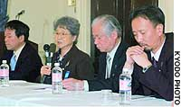 Sakie Yokota (second from left) briefs reporters Monday in Washington after talks with Sen. Sam Brownback.