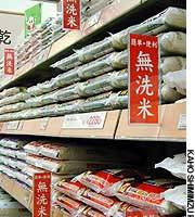 Bags of prewashed rice are displayed at Ito-Yokado Co.'s Kiba outlet in Koto Ward, Tokyo, with red tags indicating the rice needs no further rinsing.