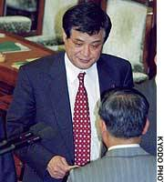 House of Representatives lawmaker Takanori Sakai casts a vote during a plenary session.