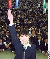 A vocational school student, representing some 3,000 students in Tokyo's Hibiya Park, states her resolve to land a job after she graduates in April 2004.