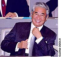 Tokyo Gov.  Shintaro Ishihara smiles during Friday's session of the Tokyo Metropolitan Assembly, during which he announced his intention to seek re-election.