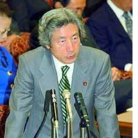 Prime Minister Junichiro Koizumi addresses the House of Councilors Audit Committee.