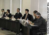 Participants (from left) Yasuo Sakata, Paula Nakayama, Dale Minami, Robin Toma, Hideo Yamagishi and Kip Tokuda field questions during a symposium in Tokyo on Japanese-Americans' place in U.S. society.