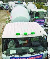 Displaying an antiwar banner, a giant concrete mixer leads a convoy of 200 vehicles from an industrial waste disposal site in Suminoe Ward, Osaka, for a downtown demonstration. Some 1,200 concrete industry union members took part in the protest.