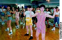 Pregnant women engage in aerobic exercises in a Tokyo gym.