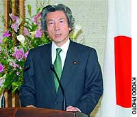 Prime Minister Junichiro Koizumi talks to reporters at his official residence in Tokyo.