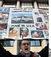 Sulejman Brkic, a Bosnian living in Japan, protests at the U.S. Embassy after President George W. Bush delivered an ultimatum to Iraq.