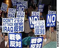 Antiwar groups and labor unions protest outside JR Harajuku Station in Tokyo.