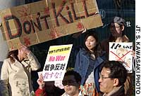 Antiwar protesters demonstrate in front of the U.S. Embassy in Tokyo.