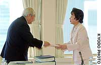 Yasuhiko Torii, chairman of the Central Education Council, submits a report on revising the Fundamental Law of Eduation to education minister Atsuko Toyama.