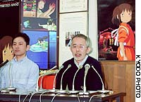 Toshio Suzuki (right), producer of the Oscar-winning animated film 'Spirited Away,' speaks during a news conference at Tokyo's Studio Ghibli after the award was announced in Los Angeles.