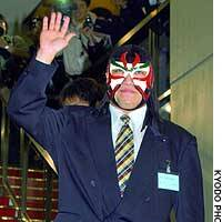 The Great Sasuke, a professional wrestler recently elected to the Iwate Prefectural Assembly, greets the media at the prefectural office.