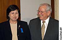 Hitomi Soga, one of five Japanese who returned home last year after being abducted to North Korea, meets Ambassador Howard Baker at the U.S. Embassy in Tokyo on Friday.