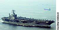 The nuclear-powered aircraft carrier USS Carl Vinson enters the U.S. Navy base in Yokosuka, Kanagawa Prefecture.