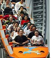Passengers scream while riding a roller coaster at an amusement park in Bunkyo Ward, central Tokyo. Neighbors are making a loud fuss as well, claiming the incessant shrieking is unbearable.