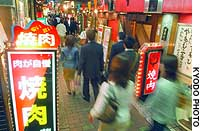 People crowd a street lined with 'yakiniku' grilled-beef restaurants in this city's Tennoji district in Osaka earlier this week.