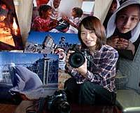 Freelance photographer Masako Imaoka shows off some of her works at her house in Toshima Ward, Tokyo.