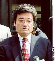 Hiroaki Serizawa talks to reporters after the U.S. federal district court in Cleveland fined him $500 for perjury.