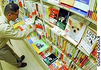 Books and magazines on dogs occupy the shelves of a bookstore in Tokyo's Nihonbashi district.