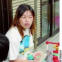 Miyuki Aotsuka, whose son and daughter are suffering health problems linked to poison gas contamination from the Japanese military, welcomes government assistance measures.