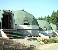 Geodesic dome cottages owned by a member of the Chino Shoho group stand on a hill commanding a spectacular view of Mount Fuji.
