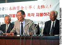 Korean veterans and former civilian workers who served under the Imperial Japanese Army during World War II speak to the media after filing a lawsuit against the government.