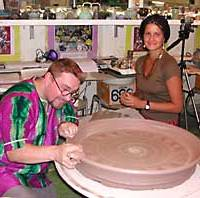 Steve Tootel, art teacher at the International School of the Sacred Heart in Tokyo, makes a plate as former student and Peace Corps volunteer Keri McGeehan looks on.